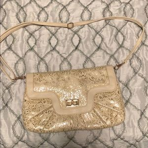 Beige and gold clutch with removable straps